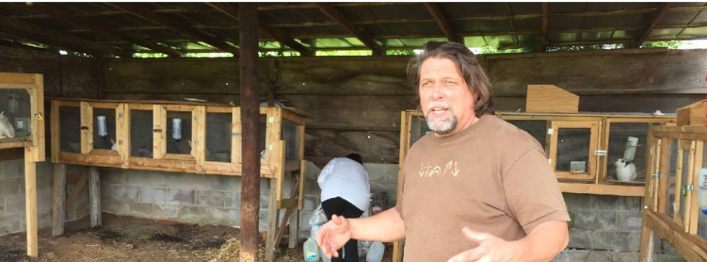 Rev. Barry Kidwell and his daughter, Kathleen, feed rabbits at the farm owned by Mustard Tree Ministries that was proposed as a site for 32 tiny homes.